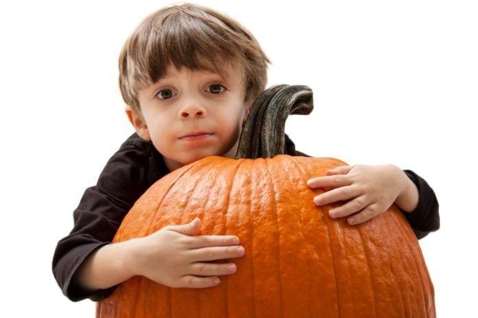 Child Hugging Pumpkin