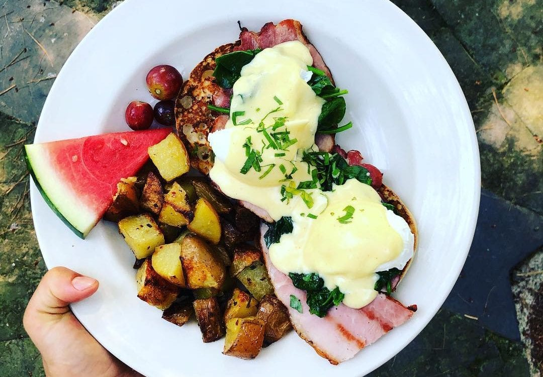 eggs benedict with potatoes and watermelon