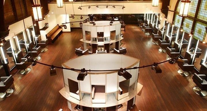 overhead view of main area with variety of workstations and mirrors