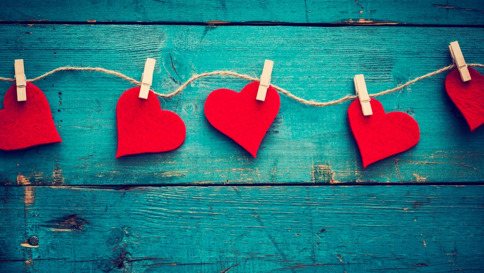 string of hearts attached by clothespins