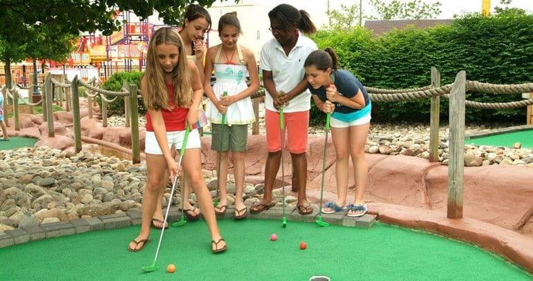 children surrounding a player