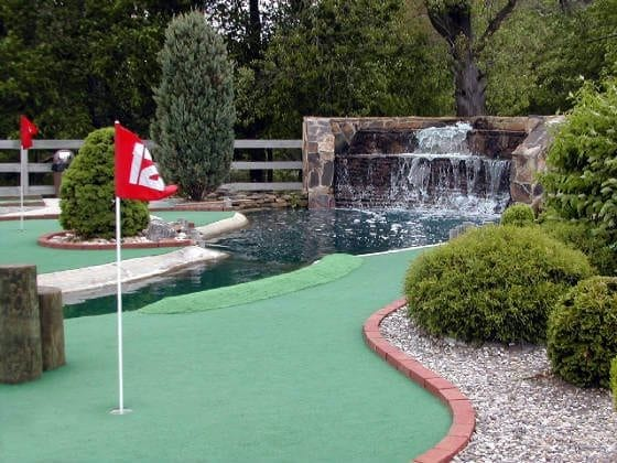red flag and waterfall past putting holes