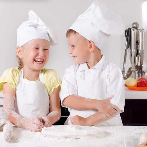 Supercilious little boy chef