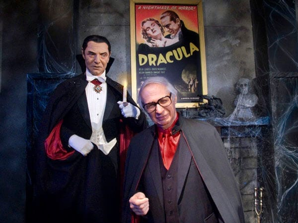 """Kreskin poses with a figure of Bela Lugosi as """"Dracula"""" from """"The Witch's Dungeon Classic Movie Museum"""""""
