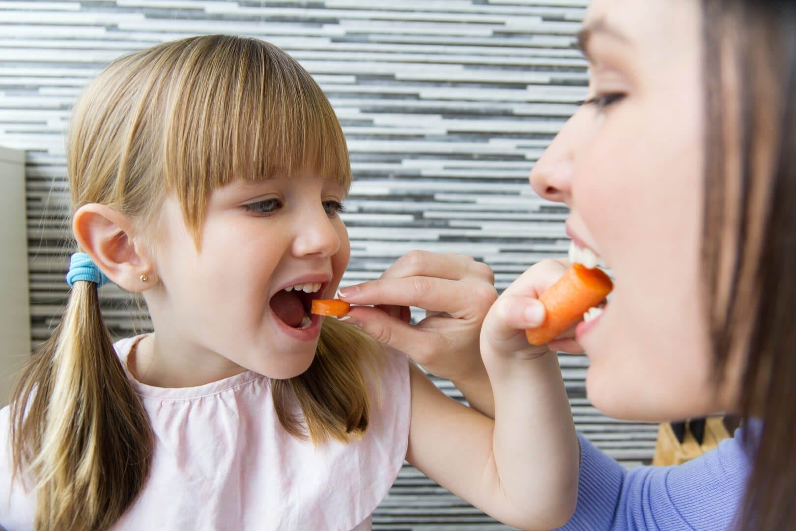 parent and child practicing healthy eating habits
