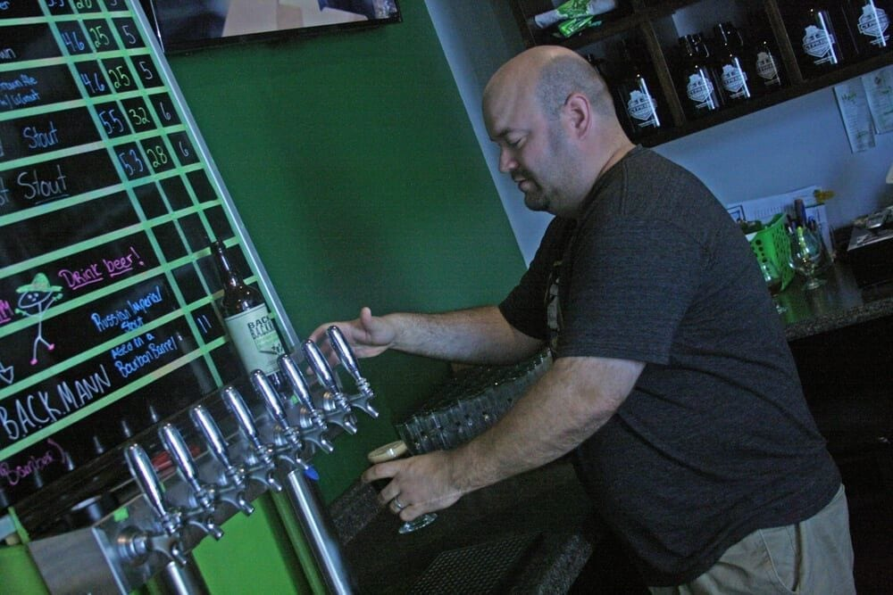 Owner Pouring Beer from Tap