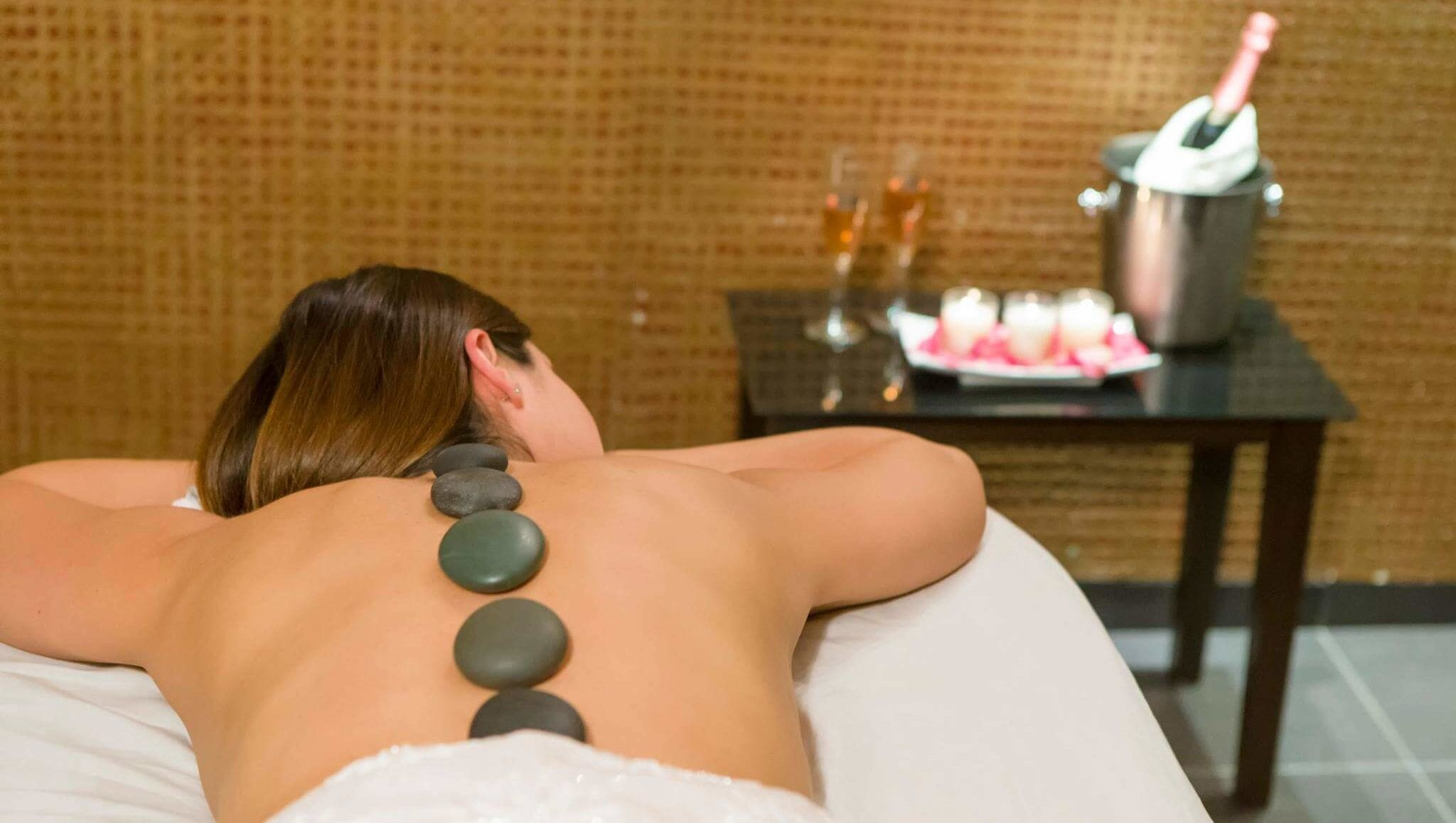 pampered at the spa with hot stone massage