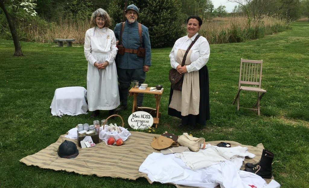 group of reenactors in a grassy field along historical hiking trail