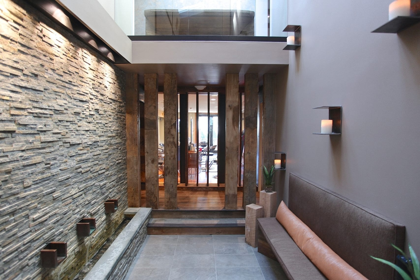 spa waiting room with stone walls and candles