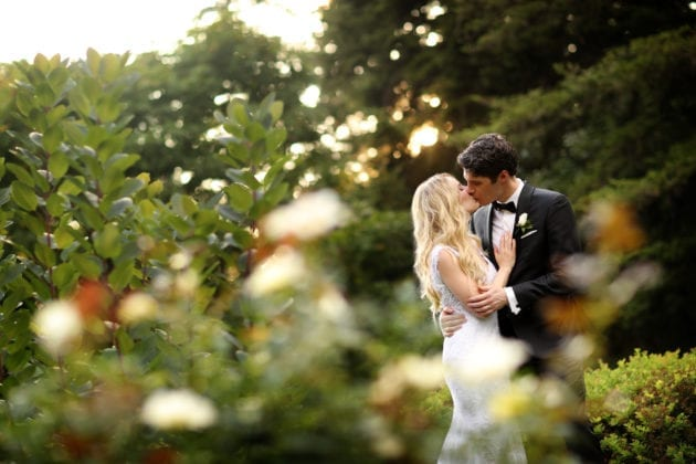 Gabelli Studio Couple Kissing in Garden