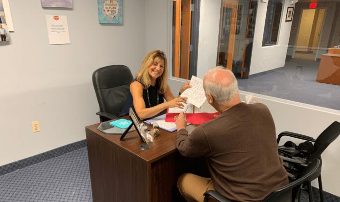 Jerri Bavaro Smiling with Happy Client