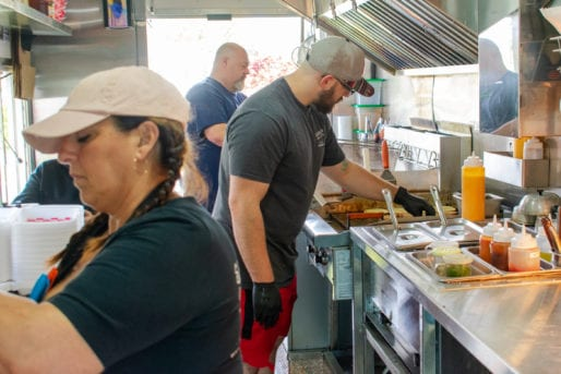 The Fahnholz Family Working Inside Shore Good Eats N' Treats Food Truck